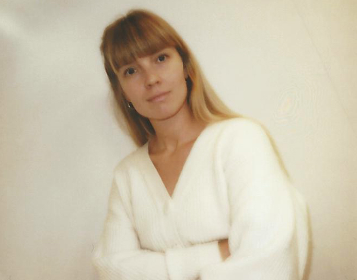 Photograph of Sara Martinsen, a young woman with long blonde hair and light coloured sweater.
